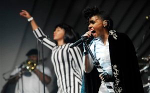 Janelle Monáe, right, performs with her band during a launch party for the Audi M3 on Thursday, April 3, 2014 in West Hollywood, Calif. (Photo by Chris Pizzello/Invision/AP)